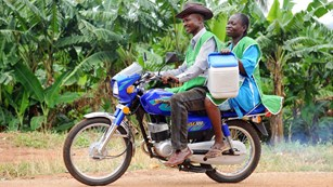 Healthcare workers carrying vaccines on a motorbike to remote communities, Nigeria